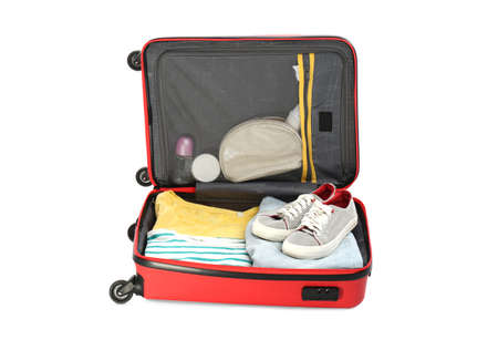 Packed suitcase with deodorants and clothes on white background Stockfoto