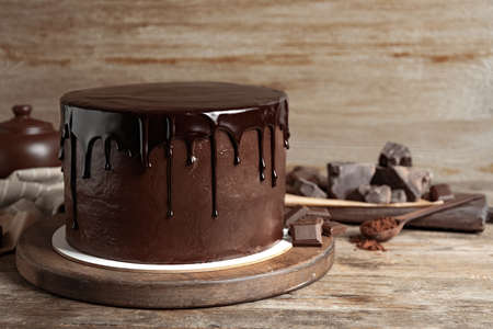 Freshly made delicious chocolate cake on wooden table. Space for text Stock fotó