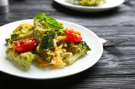 Tasty broccoli casserole served on black wooden table Reklamní fotografie - 132239113