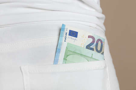 Person with Euro banknotes in pocket of jeans, closeup Stok Fotoğraf