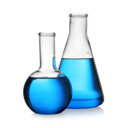 Florence and conical flasks with blue liquid on white background. Laboratory glassware Reklamní fotografie