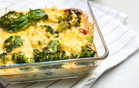 Tasty broccoli casserole in baking dish on table, closeup Banco de Imagens