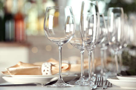 Table setting with empty glasses, plates and cutlery indoors Banco de Imagens