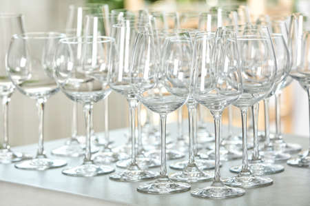 Set of empty glasses on grey table