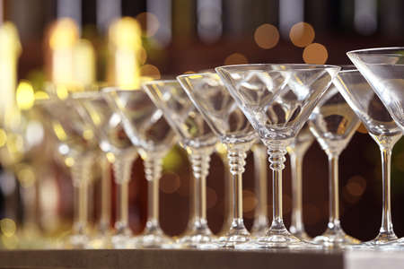 Empty martini glasses on table against blurred background Banco de Imagens