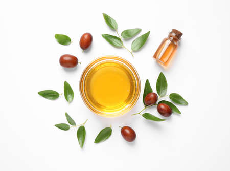 Bowl with jojoba oil and seeds on white background, top view Archivio Fotografico - 132291761