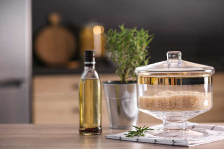 Jar with rice on wooden table in modern kitchen