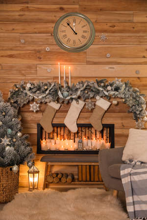 Festive room interior with decorative fireplace and Christmas stockings