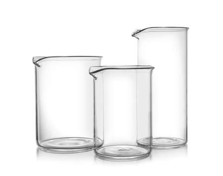 Clean empty glass beakers on white background