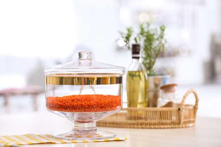 Red lentil on wooden table in modern kitchen Stok Fotoğraf