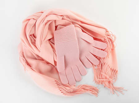 Stylish gloves and scarf on white background, top view. Autumn clothes
