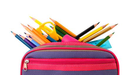Case full of color pencils and school stationery on white background
