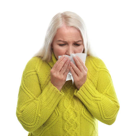 Mature woman suffering from cold on white background