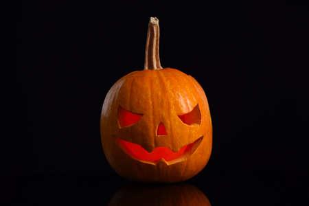 Pumpkin head on black background. Jack lantern - traditional Halloween decor