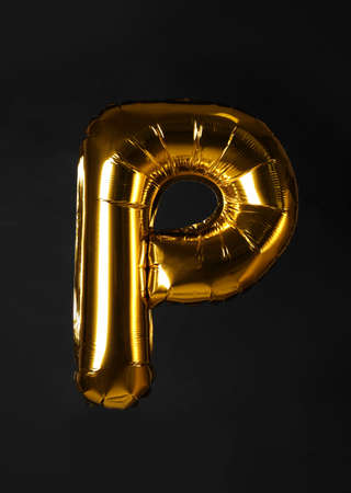 Golden letter P balloon on black background