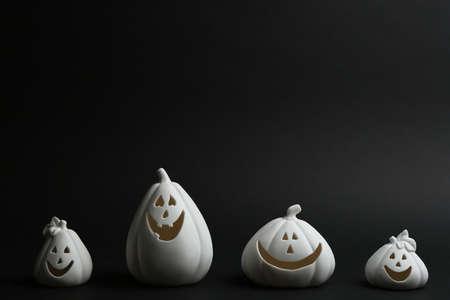 Jack-o-Lantern candle holders on black background. Halloween decor