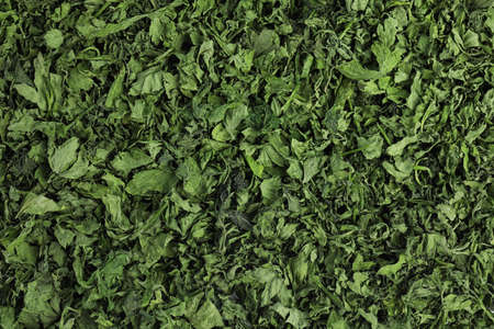 Heap of dried parsley as background, top view