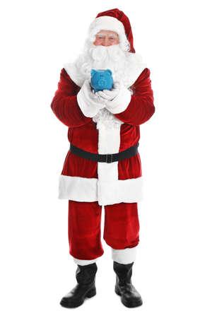 Santa Claus holding piggy bank on white background Stock Photo