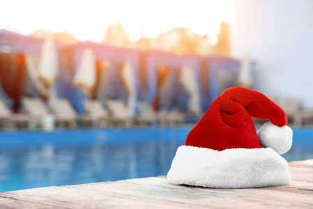 Authentic Santa Claus hat near pool at resort