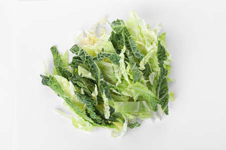 Pile of chopped fresh green savoy cabbage on white background, top view
