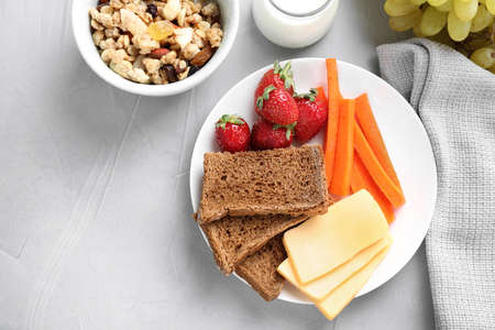 Flat lay composition with healthy breakfast on light grey table Standard-Bild