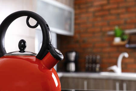 Modern kettle with whistle in kitchen, closeup. Space for text