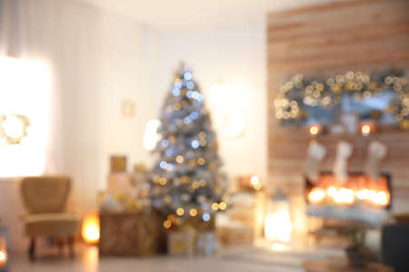 Blurred view of living room interior with decorated Christmas tree