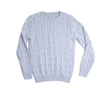 Light knitted sweater on white background, top view Foto de archivo