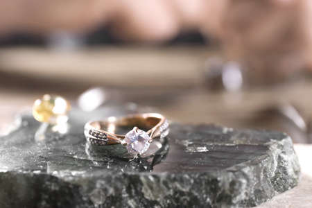 Diamond ring and blurred jeweler on background
