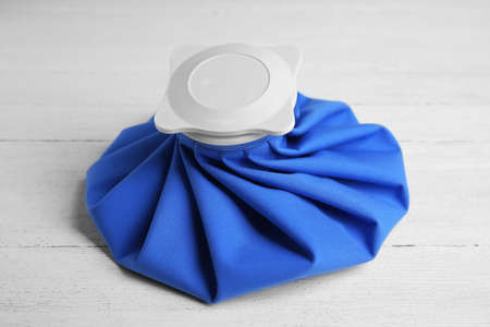 Ice pack on white wooden table. Cold compress Stok Fotoğraf