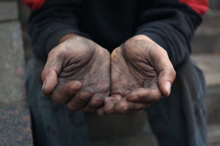 Poor homeless man begging for help outdoors, closeup Stock Photo