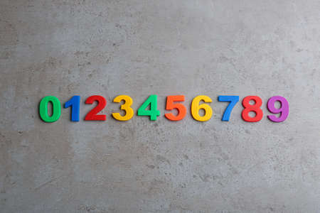 Colorful magnetic numbers on grey stone background, flat lay 스톡 콘텐츠