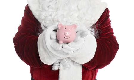 Santa Claus holding piggy bank on white background, closeup
