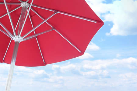 View of red umbrella and blue sky on sunny day 写真素材