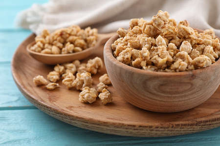 Composition with healthy granola on light blue wooden table, closeup