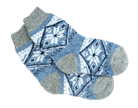Knitted socks on white background, top view