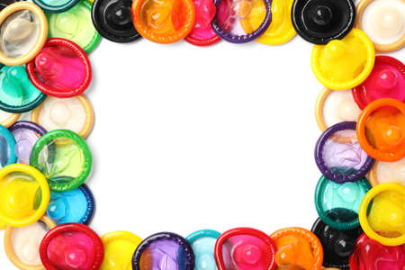 Frame made of colorful condoms on white background, top view with space for text. Safe