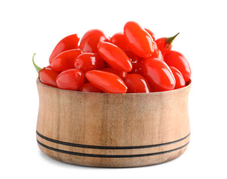 Fresh ripe goji berries in wooden bowl on white background 版權商用圖片