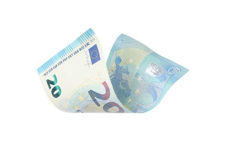Flying twenty Euro banknote isolated on white