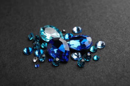 Pile of different beautiful gemstones on black background Banque d'images