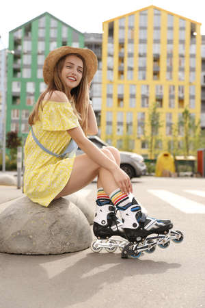 Beautiful young woman with roller skates outdoors 版權商用圖片