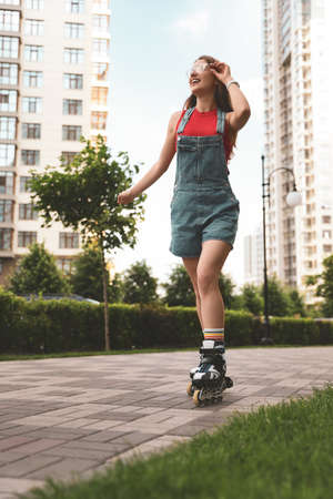 Beautiful young woman with roller skates having fun outdoors