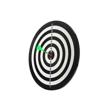 Green arrow hitting target on dart board against white background Stock Photo