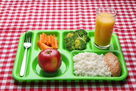 Serving tray with healthy food on checkered background. School lunch Stock Photo