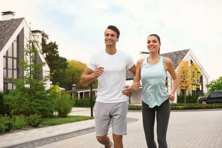 Sporty couple running on street. Healthy lifestyle