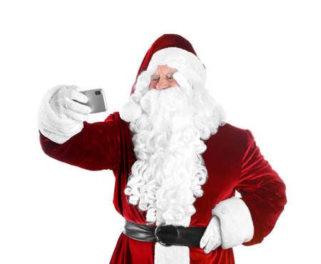 Authentic Santa Claus taking selfie on white background Stock Photo