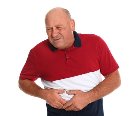 Mature man suffering from liver pain on white background Stock Photo
