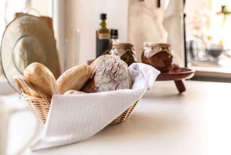 Baked goods on white table in stylish kitchen