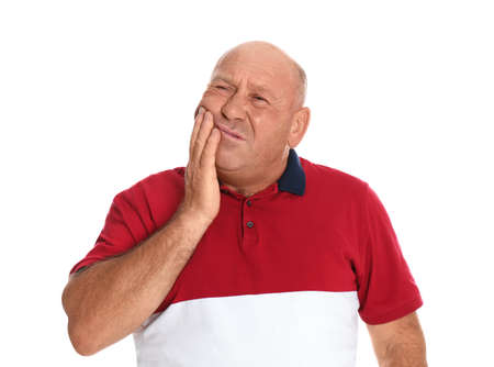 Mature man suffering from toothache on white background Stock Photo