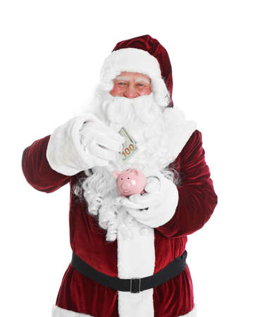 Santa Claus putting dollar banknote into piggy bank on white background Stock Photo